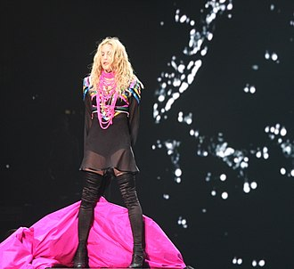 "Madonna appearing from behind a veil after the performance of ""Devil Wouldn't Recognize You"" DevilWouldntRecognizeYouSticky&SweetTour (cropped).jpg"