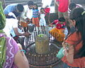 Devotees worshipping Stambheshwar Mahadev Linga during low tide at Kamboi Gujarat India.jpg
