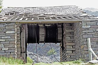 Slate industry in Wales - The drumhouse at the top of an incline housed the winding gear used to lower the loaded slate waggons down the slope. The weight of the loaded waggons would pull up empty waggons. This drumhouse is at Dinorwig Quarry