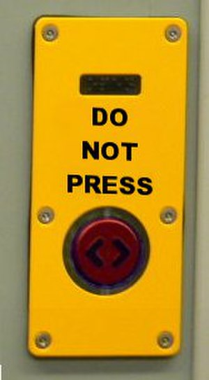 Reverse psychology - A stereotypical joke sign, inviting the user not to press it