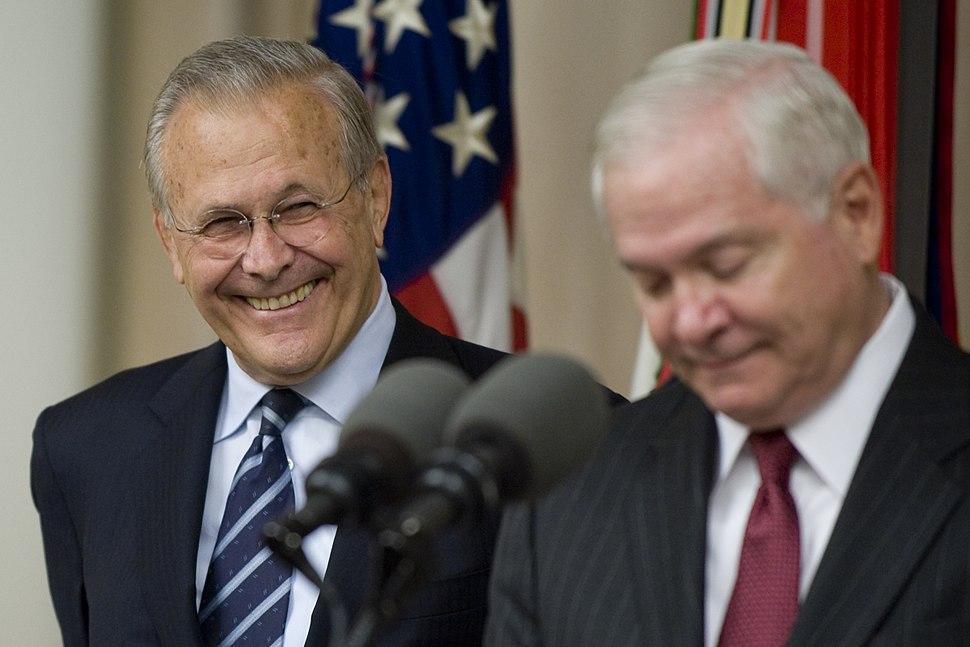 Donald Rumsfeld shares a laugh with Robert Gates
