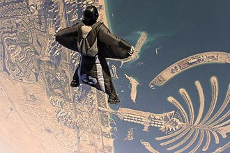 Wingsuit flying - A wingsuit flyer over Palm Islands, Dubai