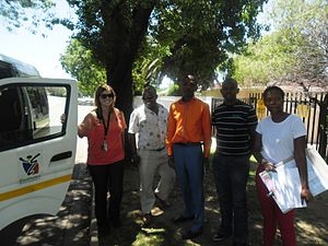 Racial integration - Planners from the Ekurhuleni Town Planning department on a routine site valentine in the Benoni. The team's composition is a reflection of the New South Africa racial integration policies