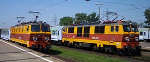PKP class EP09 - EP09-47 (left) and EP09-30 locomotives in Warsaw. Note the difference between front parts of locomotives (EP09-47 has additional air-intake mounted due to air-conditioning system installed) and between the types of pantographs.