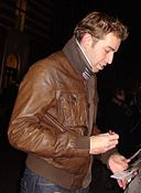 Edward Bennett signing programmes at the Novello Theatre stage door.jpg