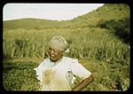 FSA - T P borrower in her garden 1a34005v.jpg
