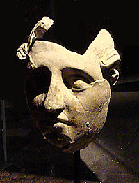 A stucco face from the ancient Greek city of Ai Khanoum, Afghanistan, 3rd-2nd century BCE.