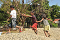 Filipino students from Manggahan Elementary School play on a pile of gravel to be used for a construction project at the school March 18, 2013, in Manggahan, Philippines 130318-N-FI367-036.jpg