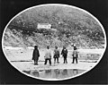 Five Kinugmiut Eskimo boys standing on beach below a house on a hillside, Kingegan, Cape Prince of Wales, Alaska, between 1901 (AL+CA 1604).jpg