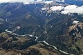 Flying over a river valley 2 (31195730211).jpg
