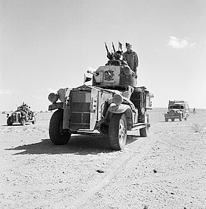 RAF Armoured Car Company - Fordson Armoured Cars and support vehicles of No. 2 Armoured Car Company RAF, leave their base for a patrol in the Western Desert, 1941.
