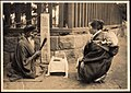 Fortune Teller on the street of Japan (1914 by Elstner Hilton).jpg