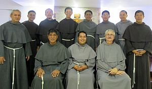 Friar - Conventual Franciscans in their variant grey habits