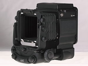 Fuji GX680 - left-/front-view of Fuji GX680III Professional Body with Standard-Bellows and closed Folding Waist-level Finder