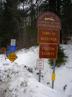 Signage along County Route 125 entering the town of Bleecker and Fulton County.