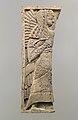 Furniture plaque carved in relief with standing woman MET DP110621.jpg