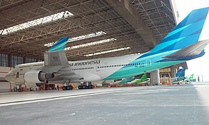 Garuda Indonesia - Garuda Indonesia Boeing 747-400 at GMF AeroAsia Hangar 2