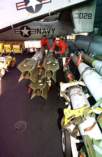 GBU-16 Paveway II - Armorers loading GBU-16s onto aircraft for transport
