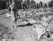 German woman reacts to exhumed victims of a death march in Nammering