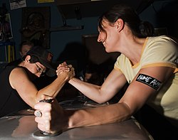 Girls arm wrestling home alive.jpg