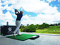 Golf professional driving on range (6891302788).jpg