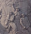 Guns, swords with hammer and sickle detail, Imperishable Nobal Spirit sculpture (cropped).jpg
