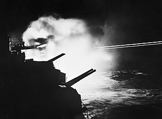 Battle of Audierne Bay - 6-inch guns of HMS  Mauritius firing during the action in Audierne Bay 23 August 1944