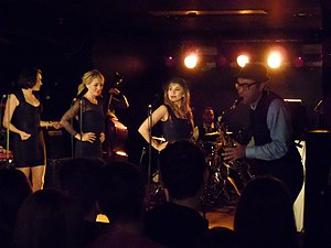 Postmodern Jukebox - Vocalists Ariana Savalas, Morgan James, and Haley Reinhart, and saxophone player Ben Golder-Novick performing with Postmodern Jukebox at a Live Concert in Cologne, March 2015