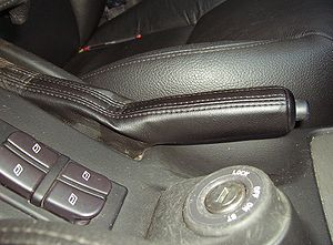Parking brake - The hand brake lever in a Saab 9-5 automobile.