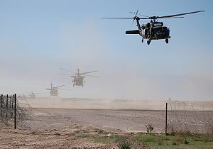 U.S. Army UH-60 Black Hawk helicopters lift of...