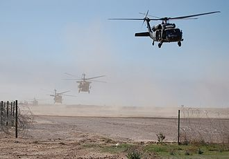 Black helicopter - Sikorsky UH-60 Black Hawk helicopters flying in Iraq.