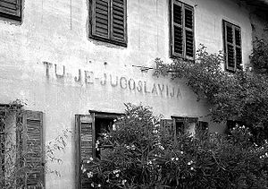 "Julian March - A house on the Italy–Slovenia border at Gorizia with the inscription ""Here is Yugoslavia"", dating from the period 1945–1947"