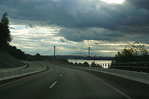 British Columbia Highway 17 - Highway 17 looking South near Port Mann (Surrey) British Columbia. New and old Port Mann Bridge in background.
