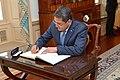 Honduran President Juan Orlando Hernandez Signs Guest Book at the State Department (33420472842).jpg
