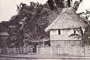 Nipa hut - Native house in the suburbs of Manila, standing on bamboo stilts, 1899