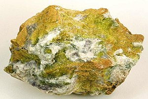 Layered double hydroxides - Hydrotalcite (white) and yellow-green serpentine, Snarum, Modum, Buskerud, Norway. Size: 8.4 x 5.2 x 4.1 cm.