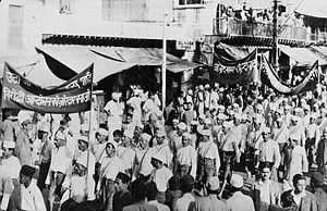 Gandhi cap - Members of the Indian National Congress marching in New Delhi in 1937