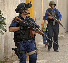 Iraqi police officer with Tabuk sniper rifle (cropped).jpg