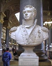Bust of a curly-haired man wearing a uniform with epaulettes.