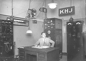 Inglewood, California - Radio engineer Ernest G. Underwood sitting at desk of his KHJ broadcasting station in Inglewood, 1927