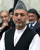 Karzai in early 2003, wearing his traditional clothes and a karakul hat.