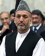 President of Afghanistan Hamid Karzai wearing his traditional Pashtun clothes and a karakul hat in 2003.