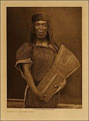 Kwakwaka'wakw man and copper shield, by Edward Curtis.jpg