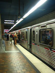 A Red Line train bound for North Hollywood stops at 7th Street/Metro Center for passengers.