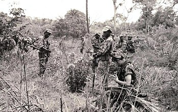 3ad580c2 Portuguese Army patrol - integrating African and European soldiers - making  a pause in the middle of the Guinean jungle, in 1968.