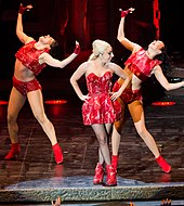 Gaga in a false meat dress with her dancers