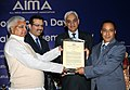 Lalu Prasad presenting the Public Service Excellence Award to Mr. Sudhir Kumar, OSD to Railway Minister, at the Foundation Day of All India Management Association (AIMA), in New Delhi on February 21, 2009.jpg