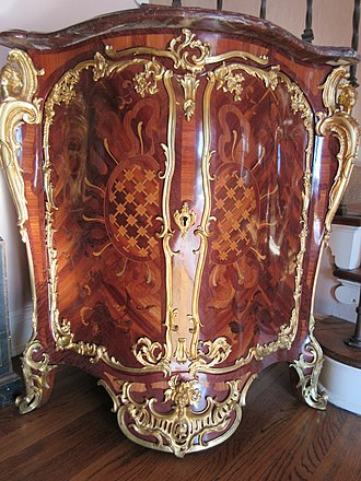 French furniture - An encoignure by royal cabinetmaker Jean-Pierre Latz circa 1750 is richly ornamented with marquetry and ormolu.