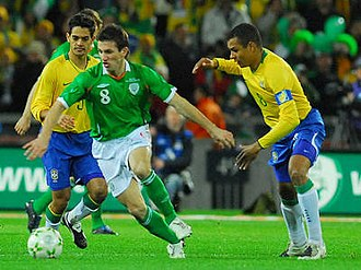 Liam Miller - Miller (in green) playing for the Republic of Ireland against Brazil in February 2008