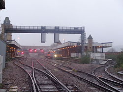 Lincoln railway station seen from the High Street level crossing (13th December 2015).JPG